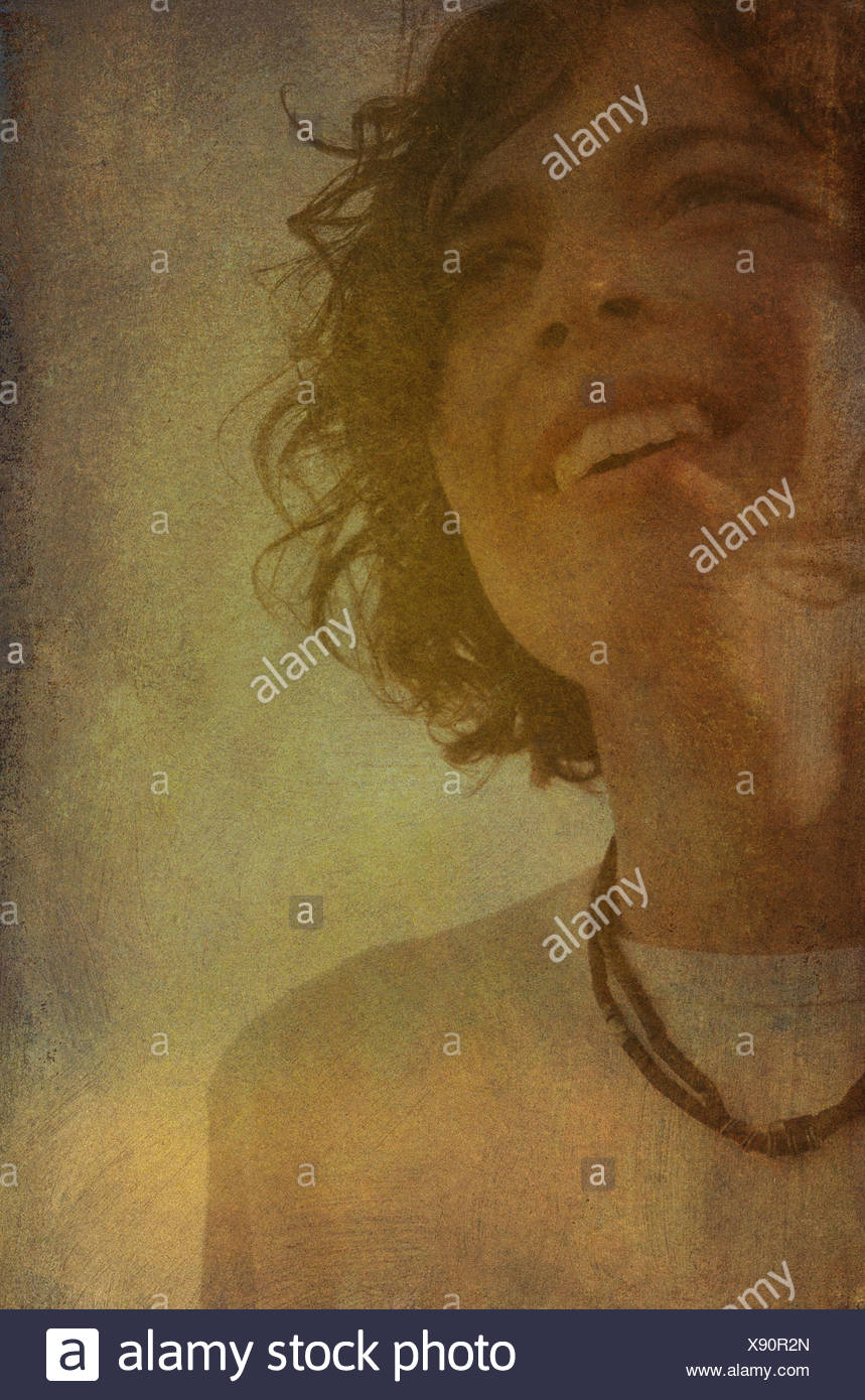 Young teenage boy with necklace - Stock Image