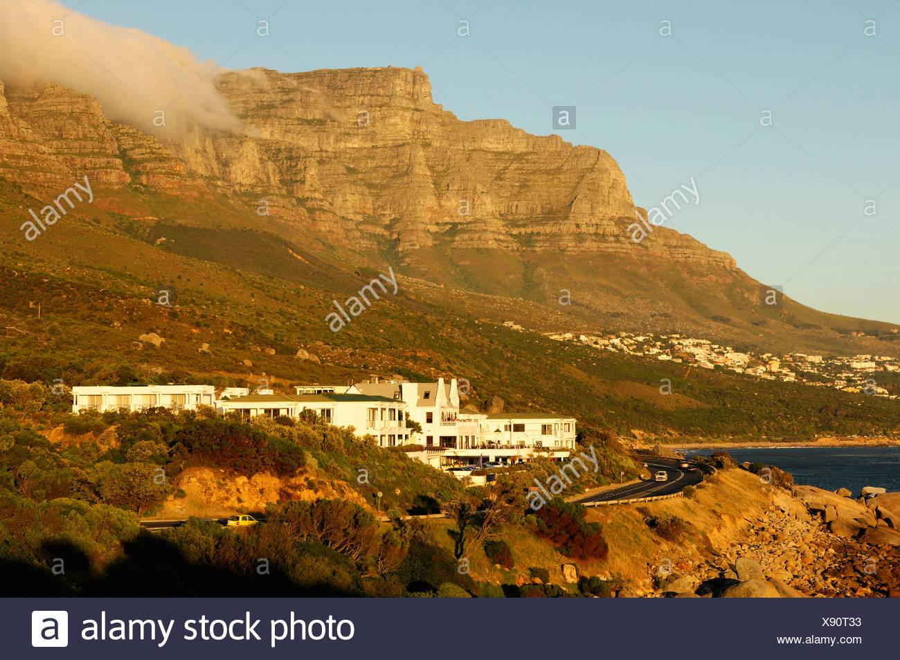 Twelve Apostles Hotel Camps Bay Cape Peninsula Western Cape South Africa coast ocean sea shore scenery mountain mountains - Stock Image