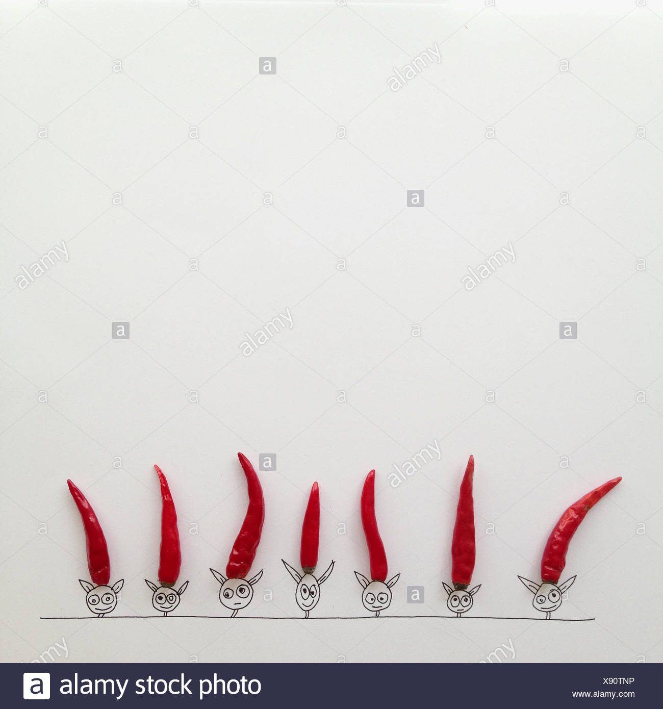 Conceptual fantasy  characters wearing red pointed hats - Stock Image