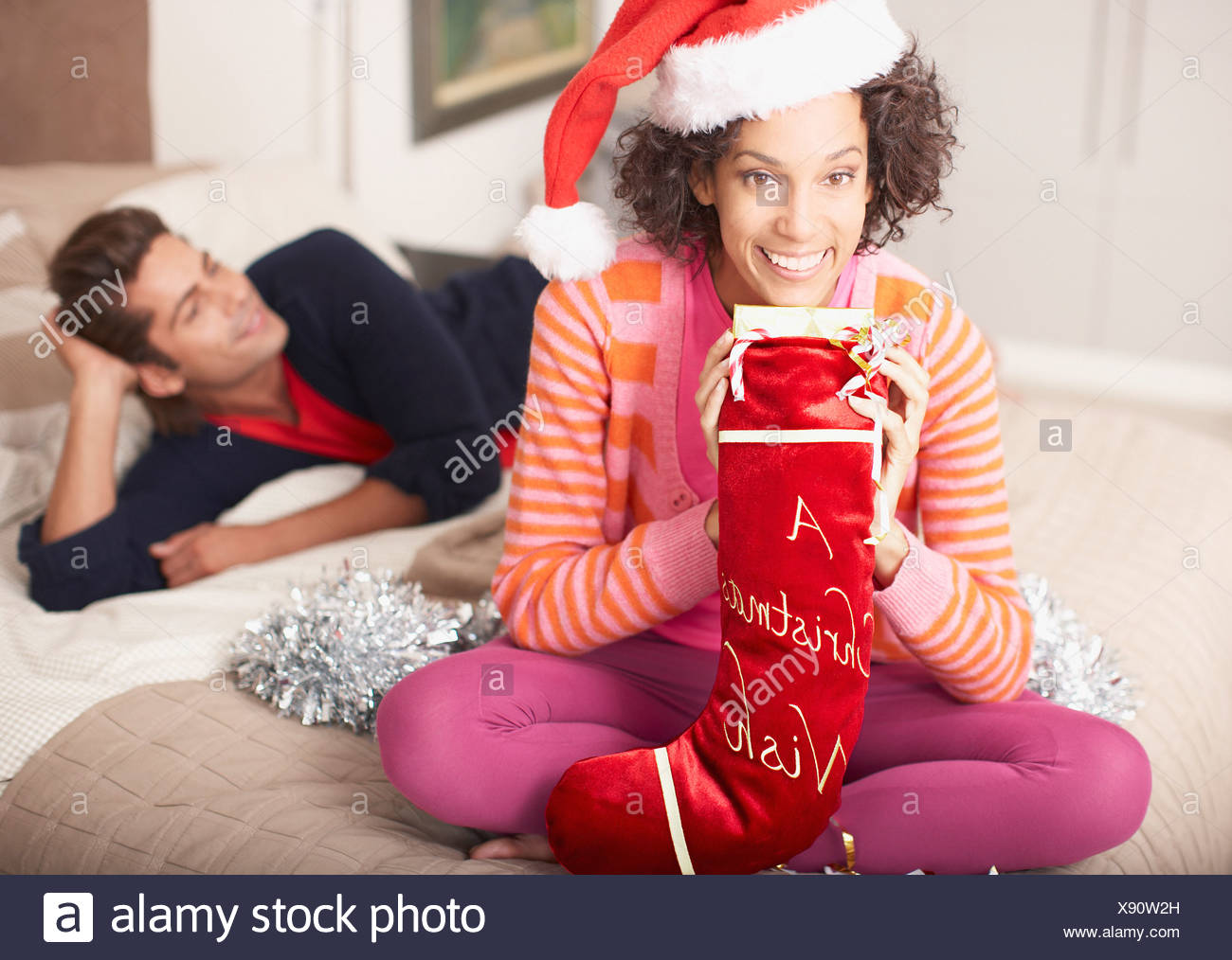 Woman holding Christmas stocking - Stock Image
