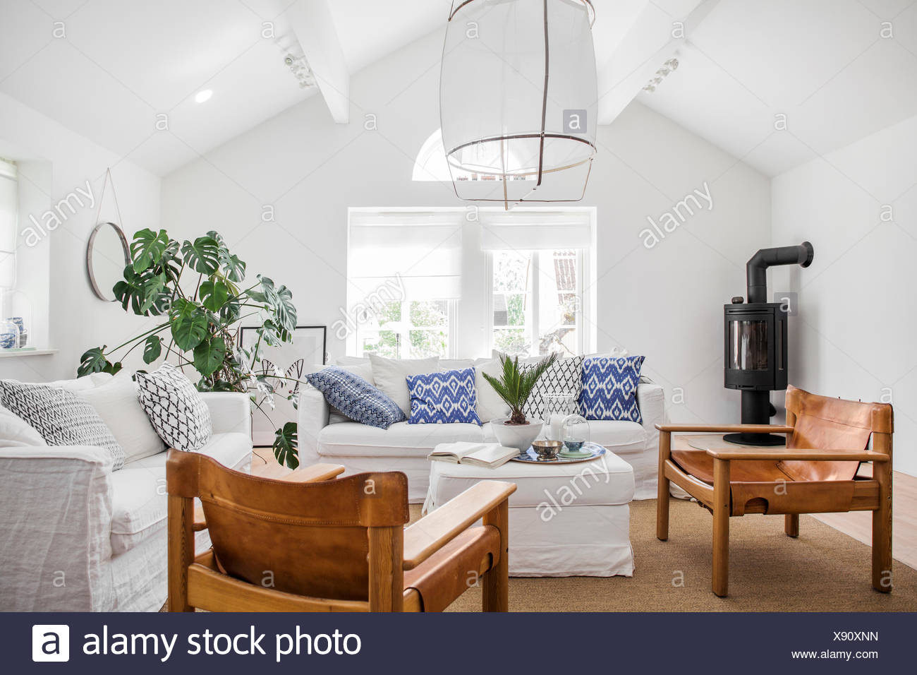 Sweden, Living Room With White Sofas And Wooden Chairs