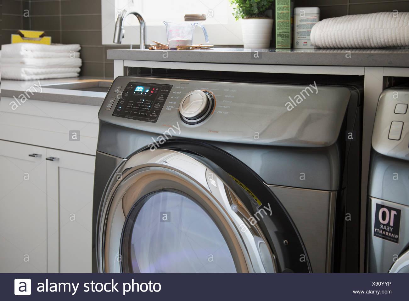 Energy efficient washing machine in laundry room - Stock Image