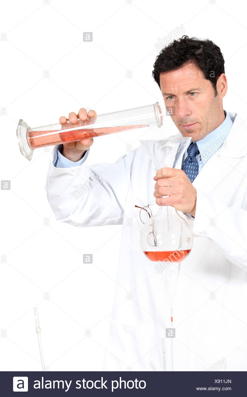 Chemist using a graduated cylinder - Stock Image