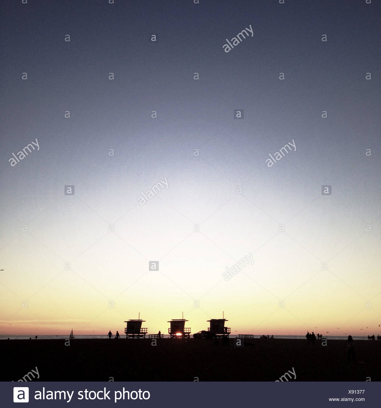 Silhouette of beach huts - Stock Image