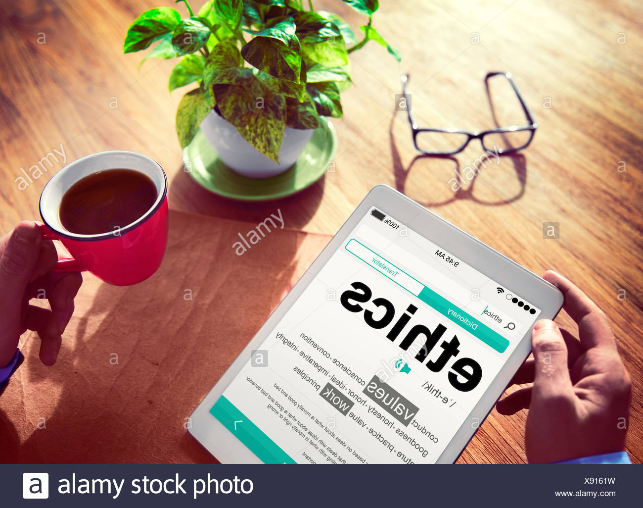 Man Reading the Definition of Ethics - Stock Image