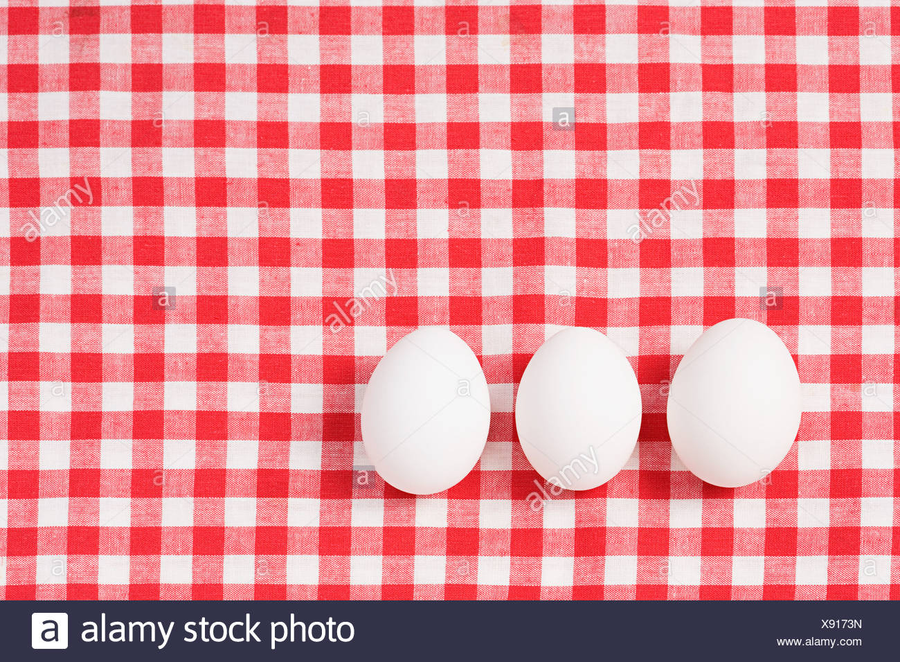 Eggs on a tablecloth Stock Photo