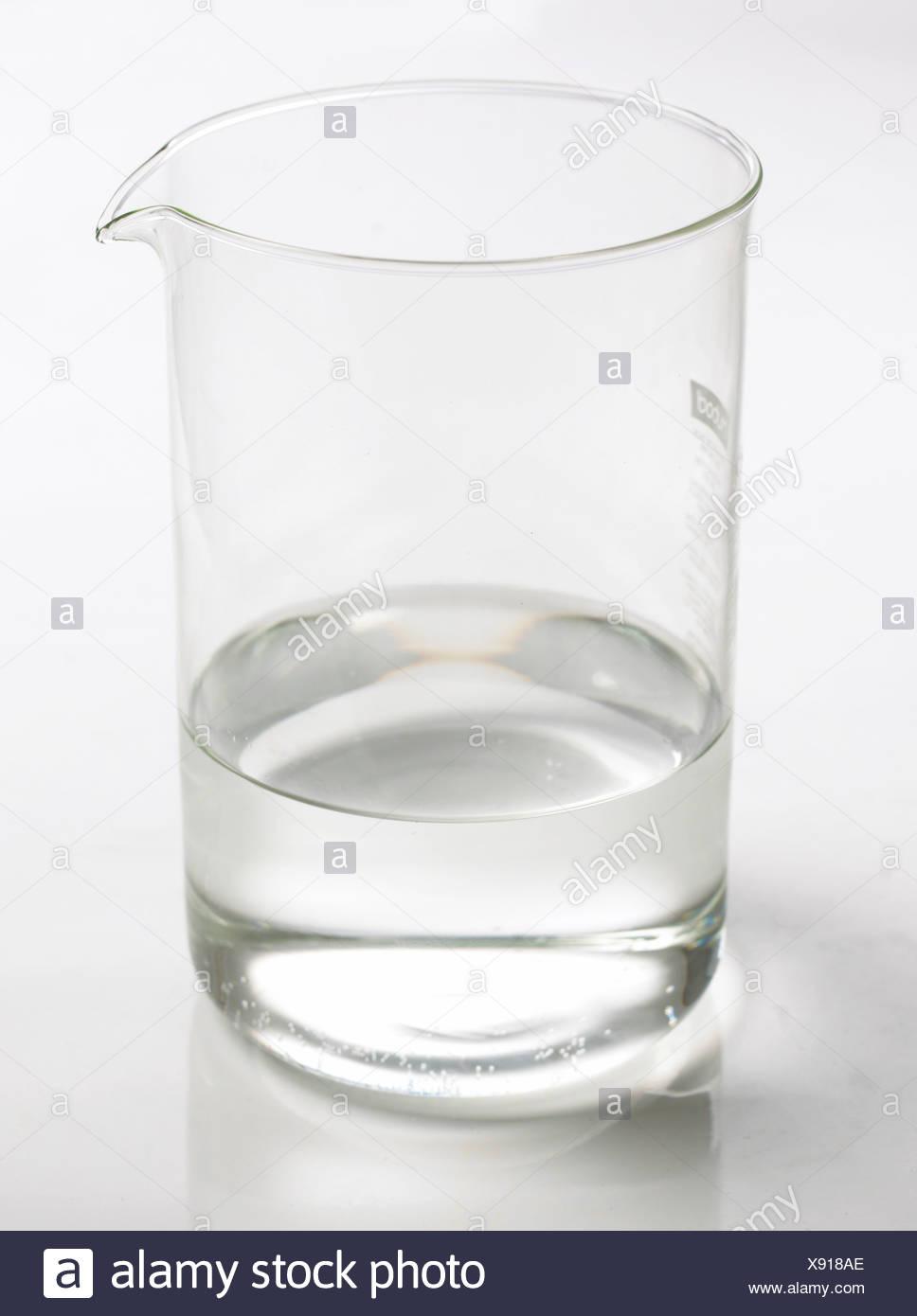 Beaker of water on white background - Stock Image