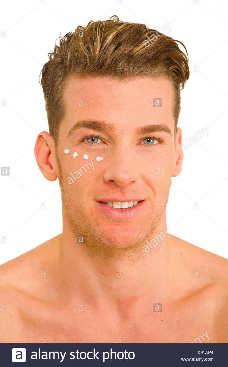 young man with anti-wrinkle cream - Stock Image