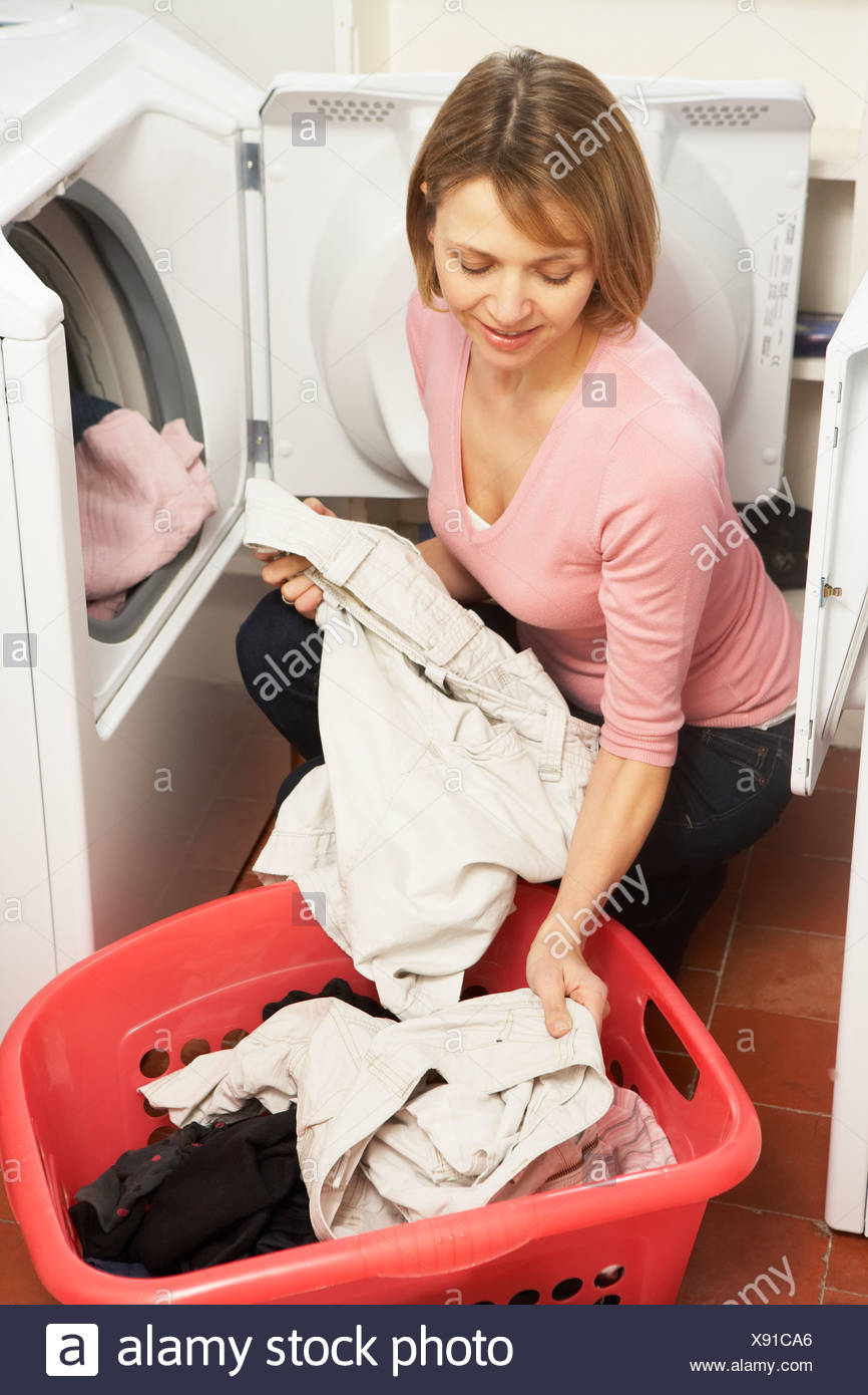 Woman Doing Laundry - Stock Image