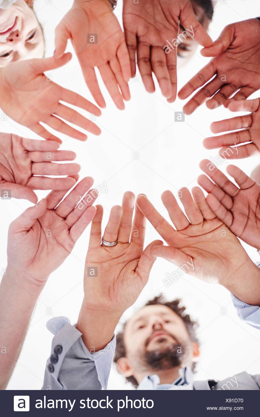 View from below   circle   open hands - Stock Image