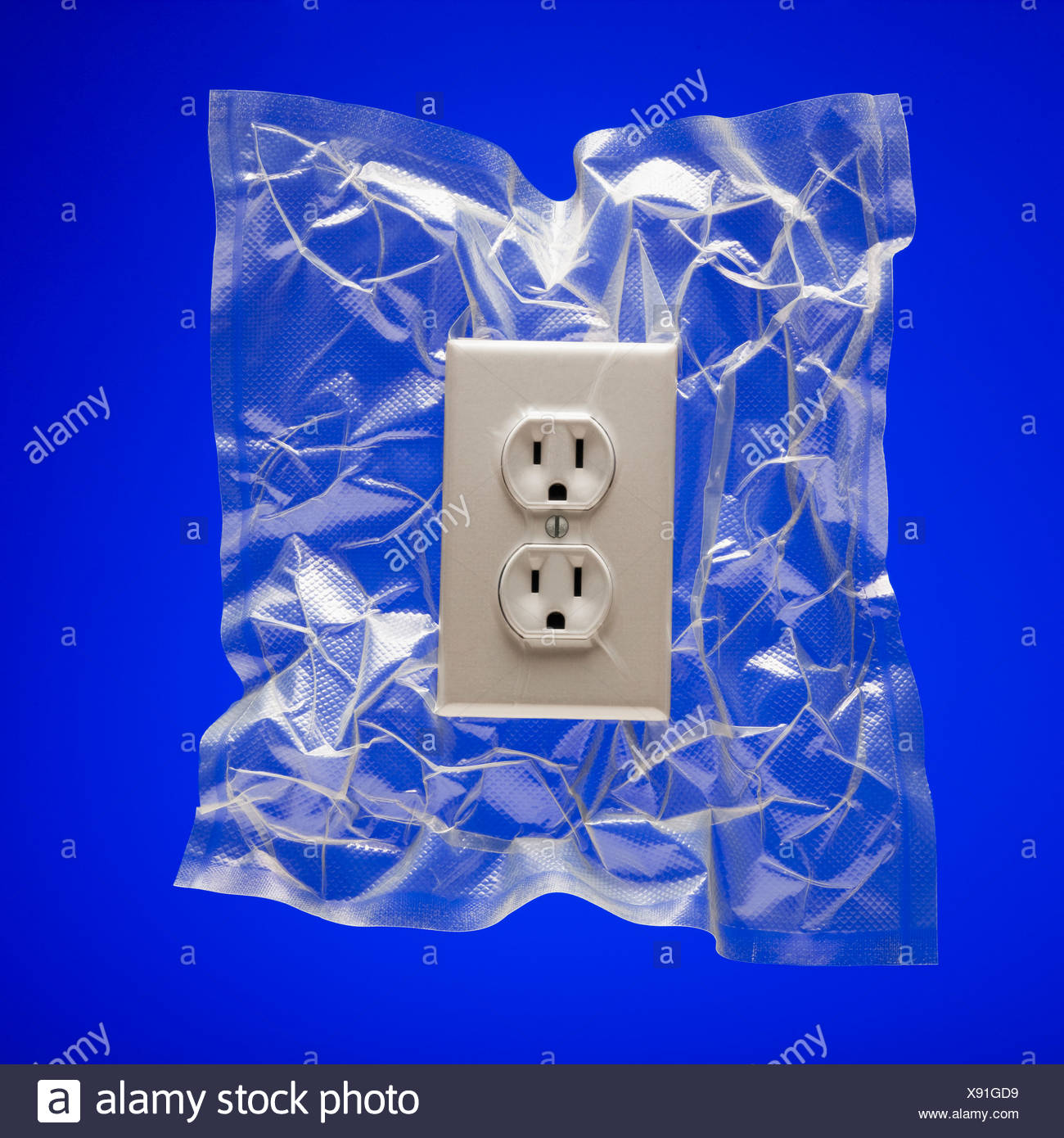 Shrink wrapped electricity receptacle - Stock Image