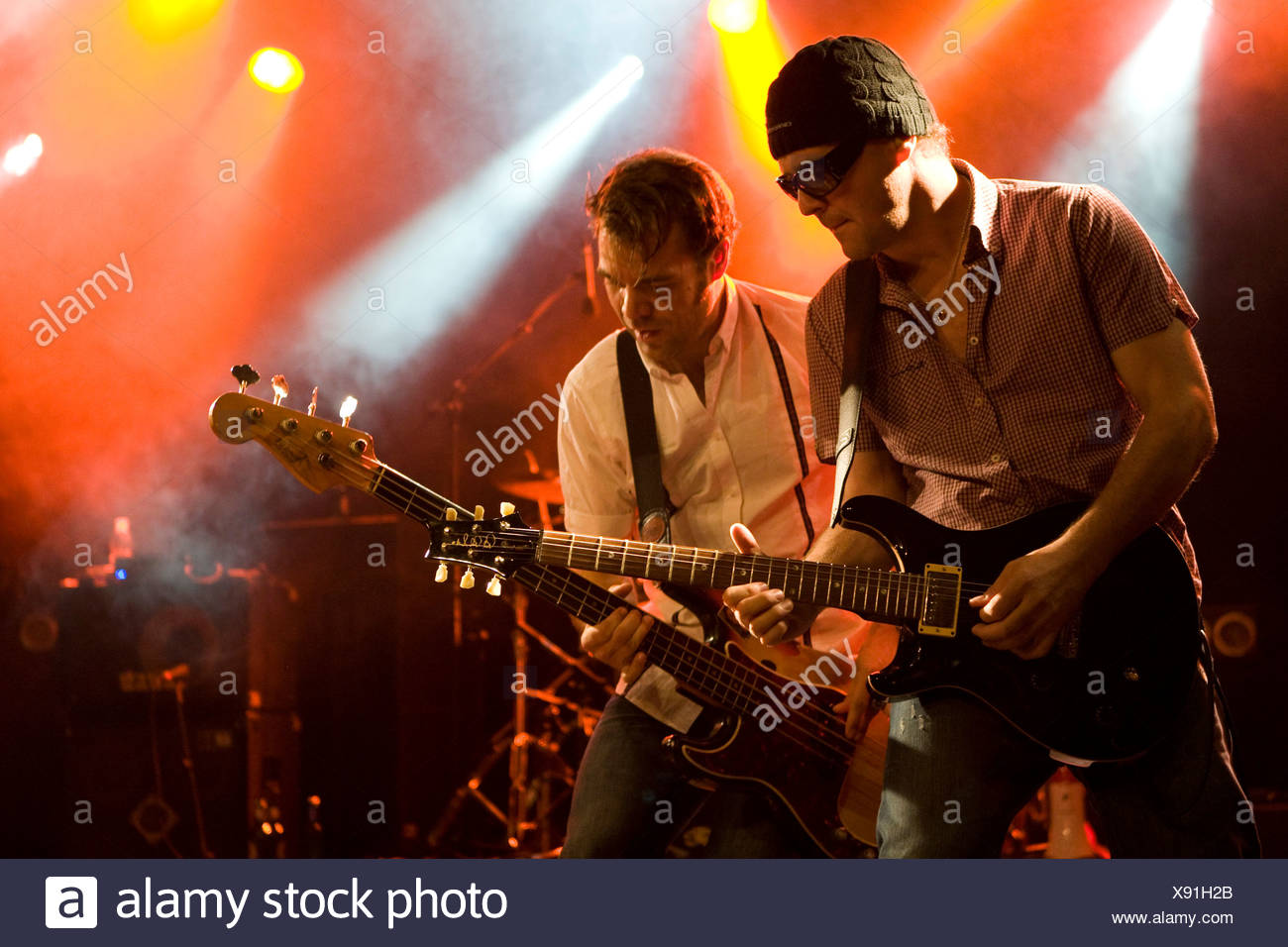 Guitarist Chris Muzik and bassist Géza Burghardt of the Swiss band, The Raveners, performing live in the Schueuer, Lucerne, Swi Stock Photo
