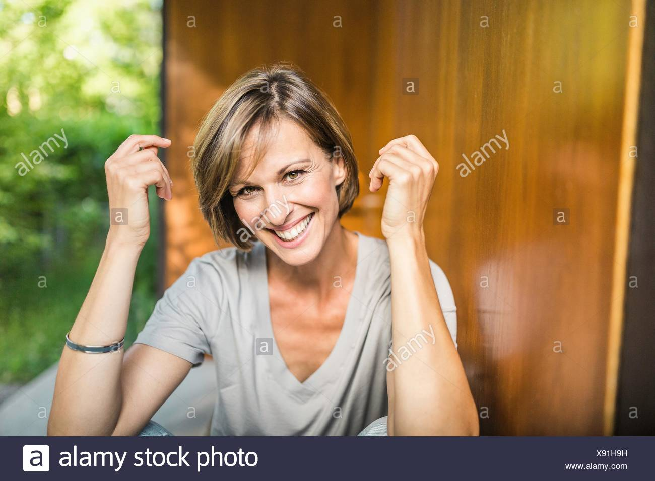 Portrait of mature woman outside house - Stock Image