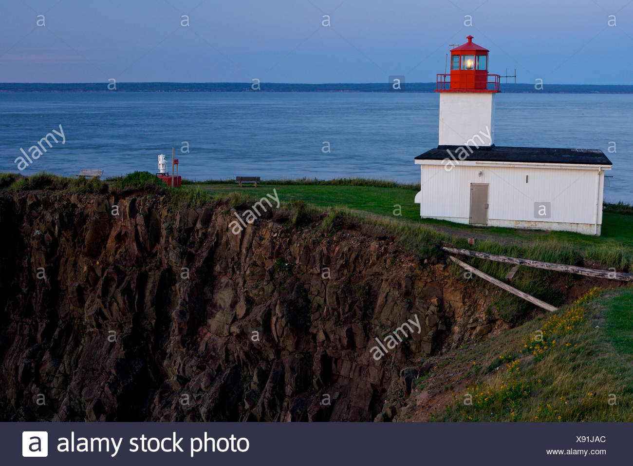 Cape d'Or Lighthouse at blue hour, Cape d'Or, Cape Chignecto, Bay of Fundy, Fundy Shore Ecotour, Glooscap Trail, Highway 209, Mi - Stock Image