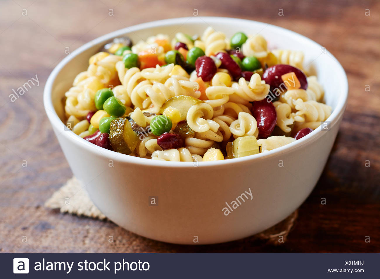 Pasta Salad With Fusilli Pasta Kidney Beans Corn Carrots Peas Pickles And Black Olives Stock Photo Alamy