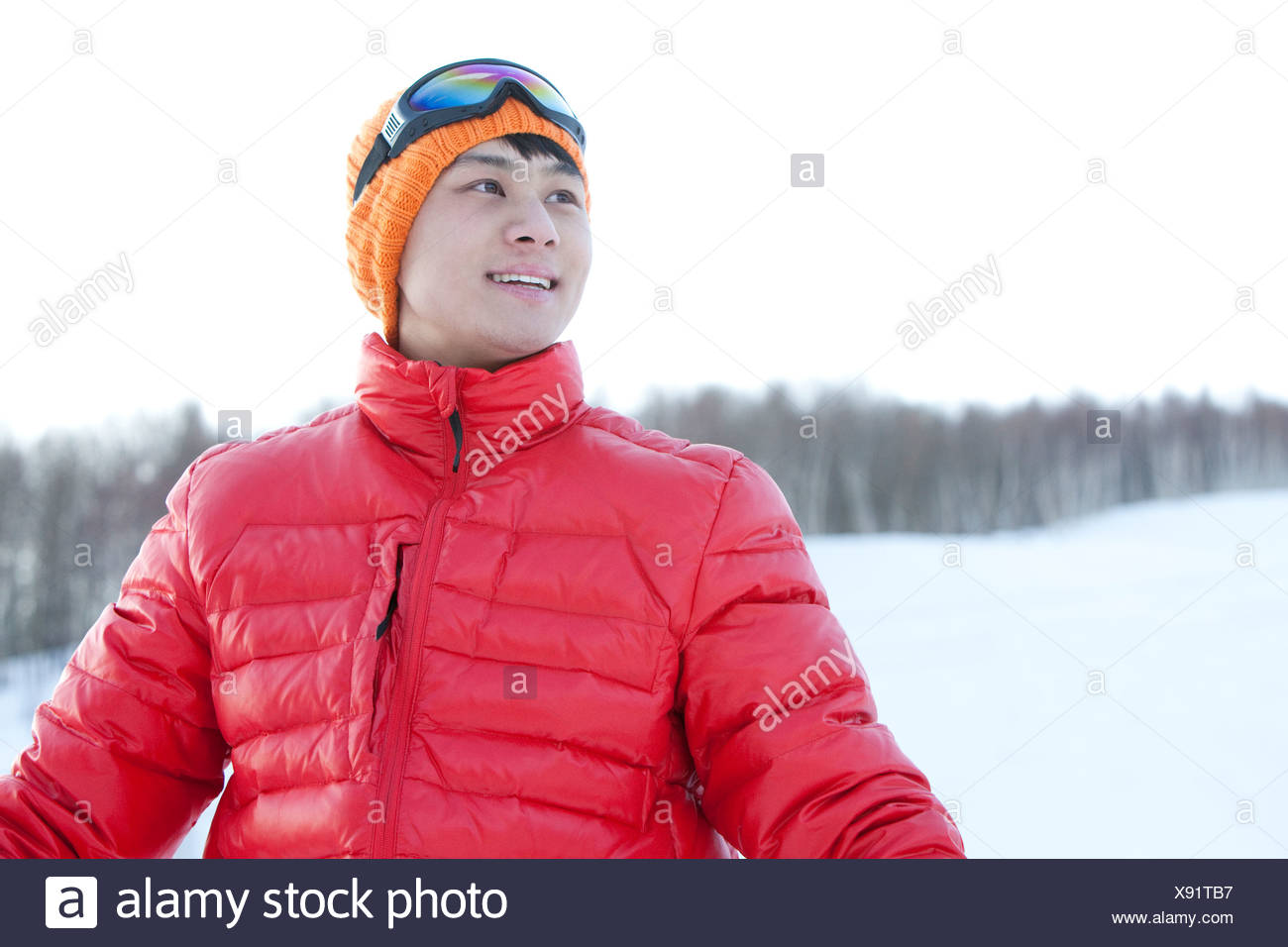 Young man in skiing resort Stock Photo