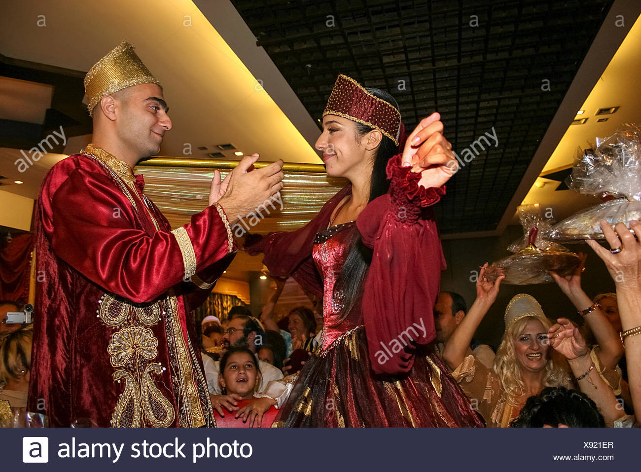The bride and groom to be, at a Jewish Moroccan, henna ceremony The Hina, also Henna, ceremony proceeds the wedding day. In this festive ceremony, nat Stock Photo