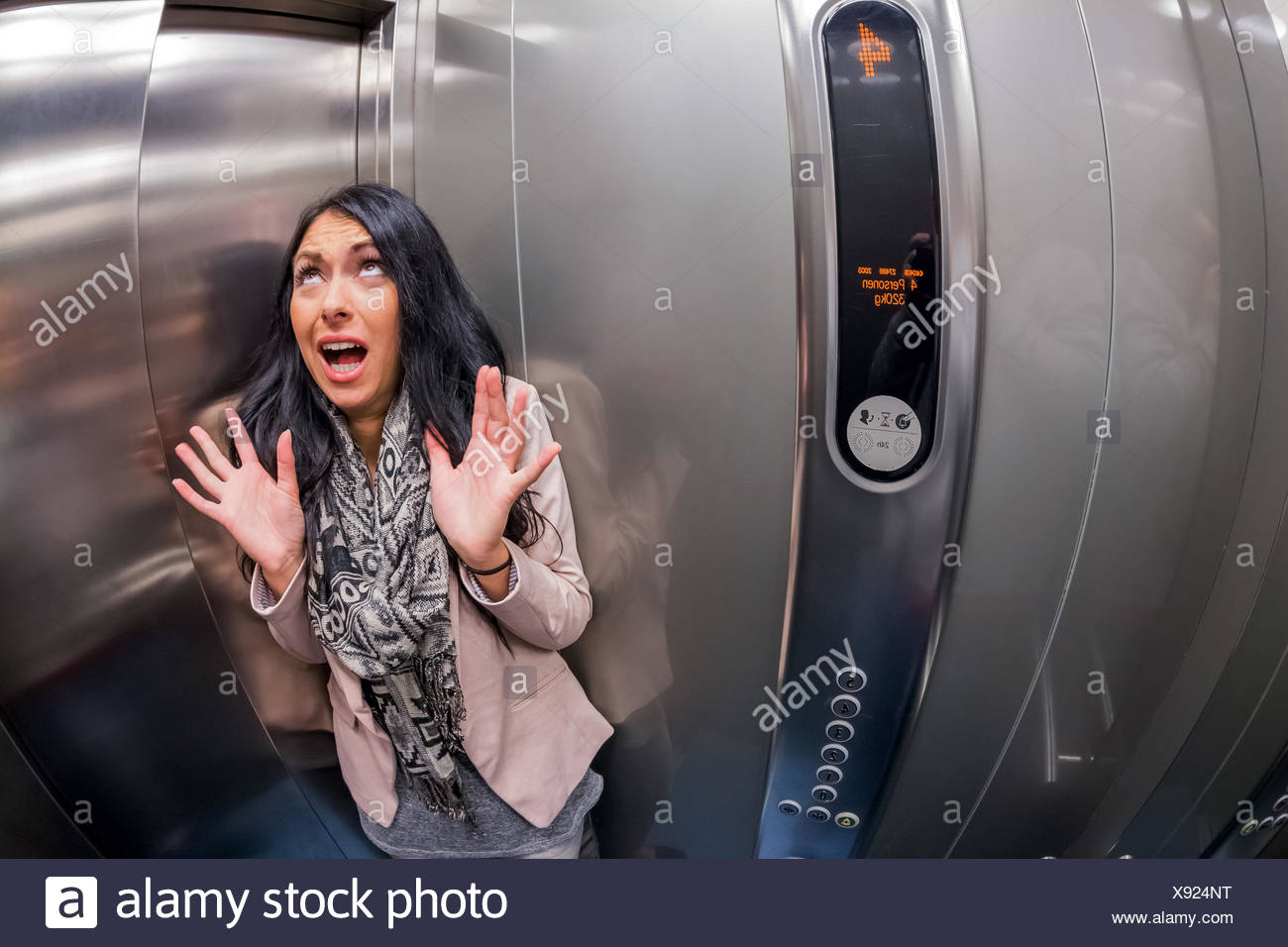 woman with claustrophobia in an elevator, Austria, Vienna - Stock Image