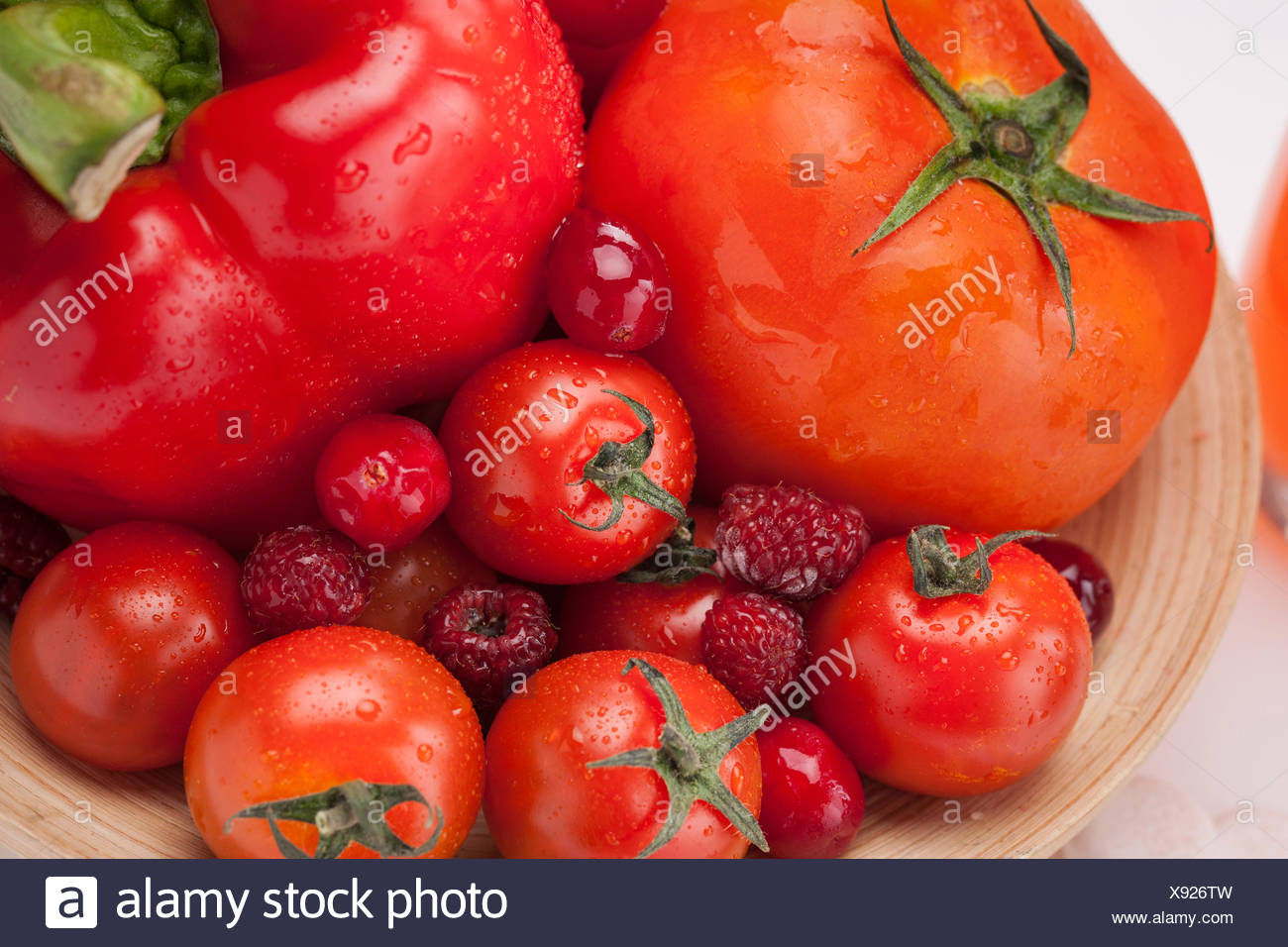 High angle of close-up of combination of red color fruits and vegetables - Stock Image
