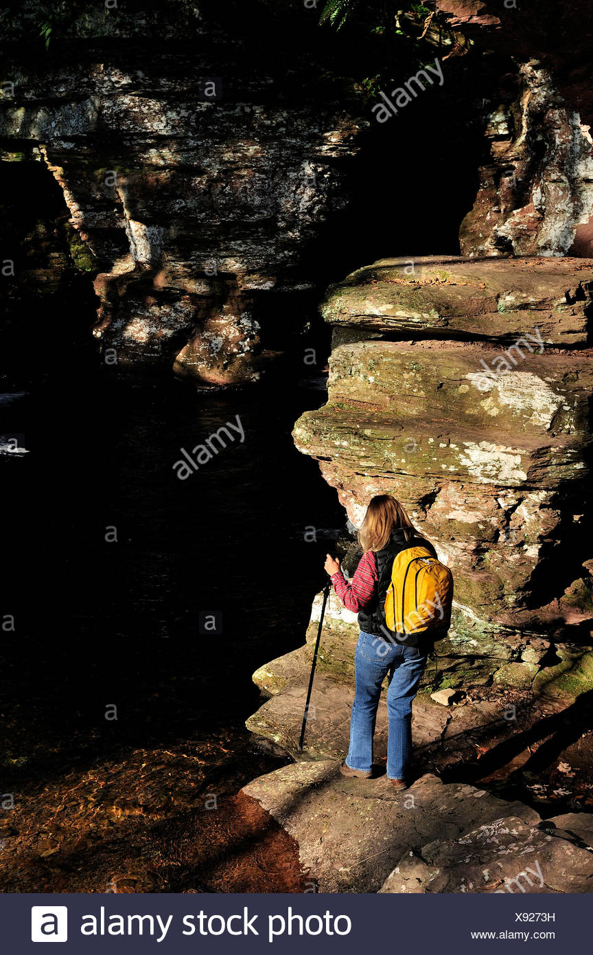 A hiker at Ricketts Glenn State Park - Stock Image