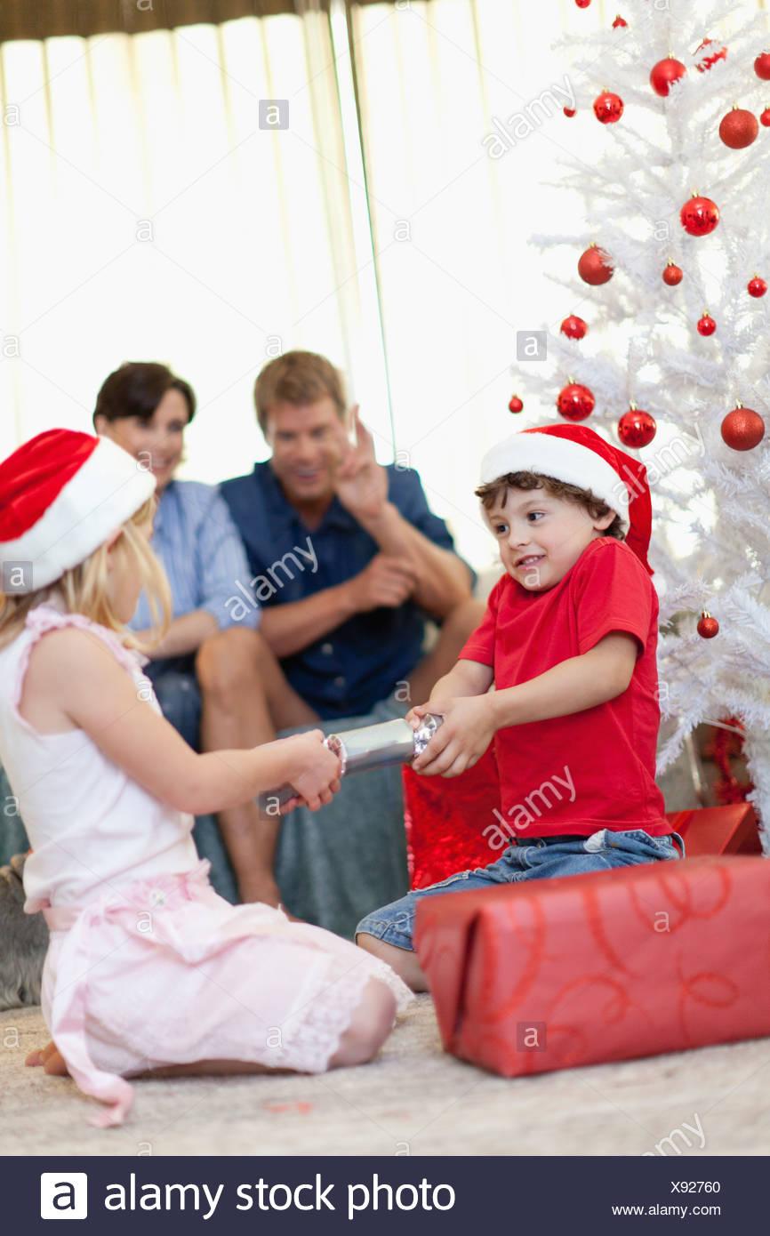 Children opening Christmas cracker Stock Photo