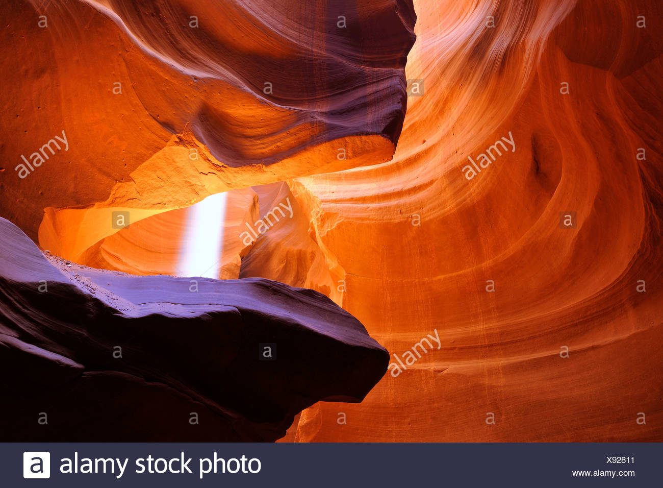 Beam of light, red sandstone of the Moenkopi formation, rock formations, colours and textures in the Upper Antelope Slot Canyon - Stock Image