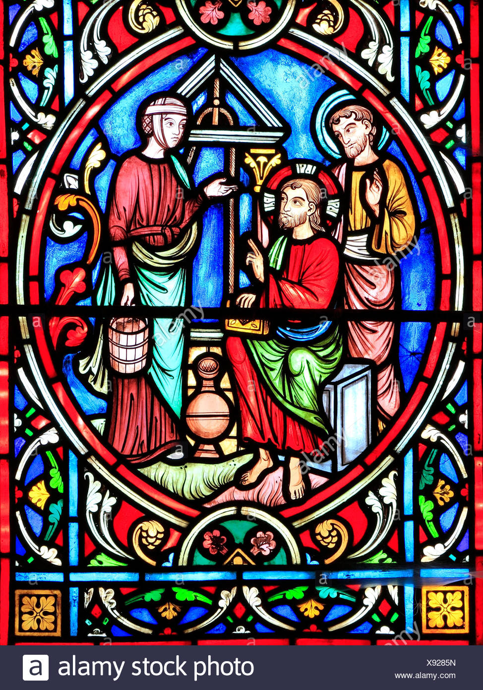 Scene from Life of Jesus, by Adolph Didron, Paris, 1860, stained glass window, Feltwell, Norfolk, England, Jesus talks to Samaritan woman, at Well - Stock Image