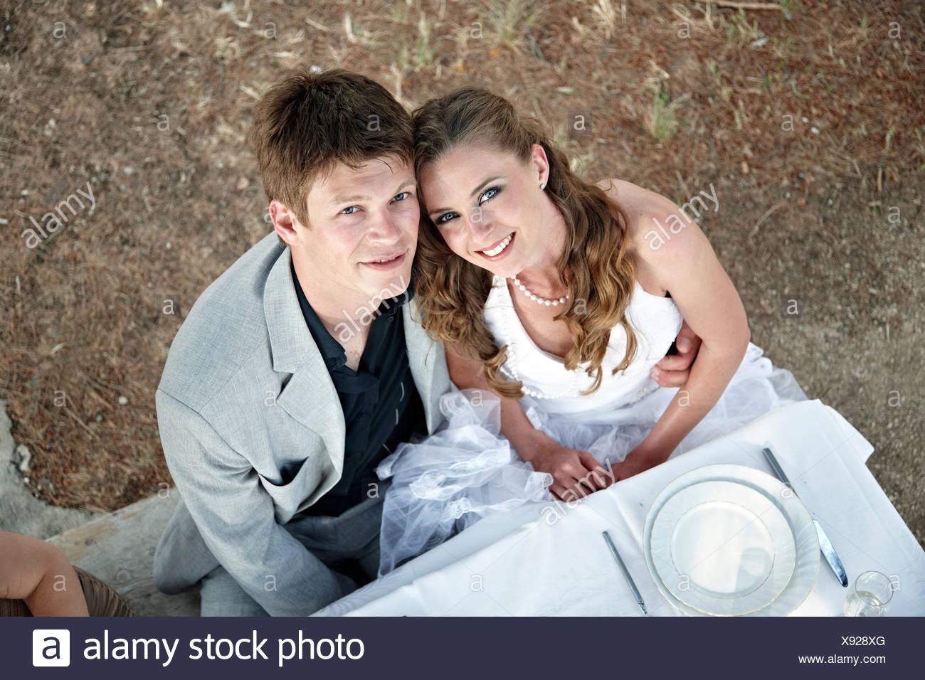 Wedding Couple On Wedding Table Outdoors, Croatia, Europe - Stock Image