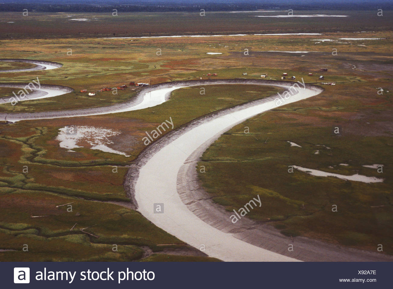 Costal Flats, Crook Inlet, Alaska, USA, snake, twisting, river, canal, channel, stream, irrigation, creek, farming, land, aerial - Stock Image