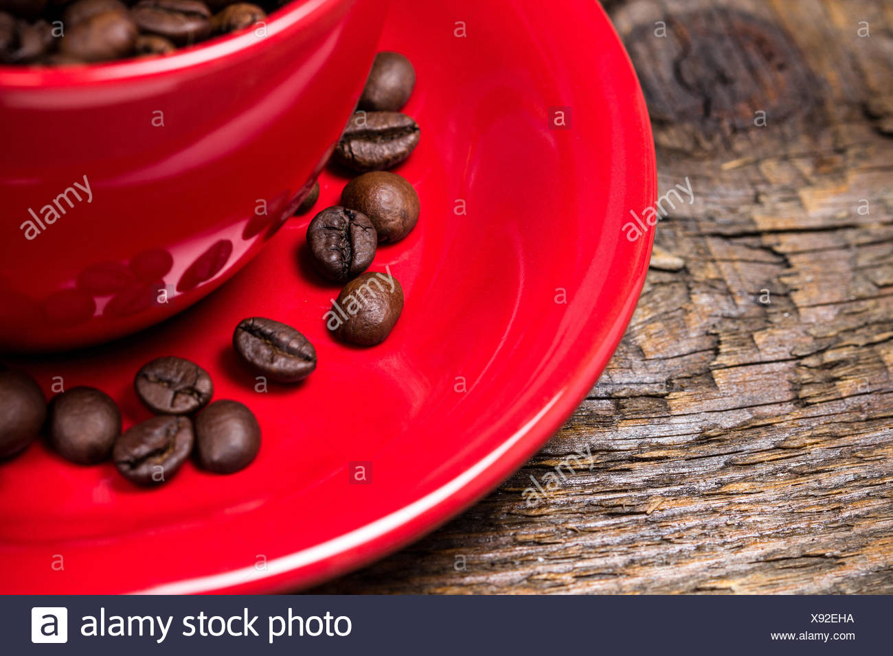 Coffee beans in red cup closeup Stock Photo
