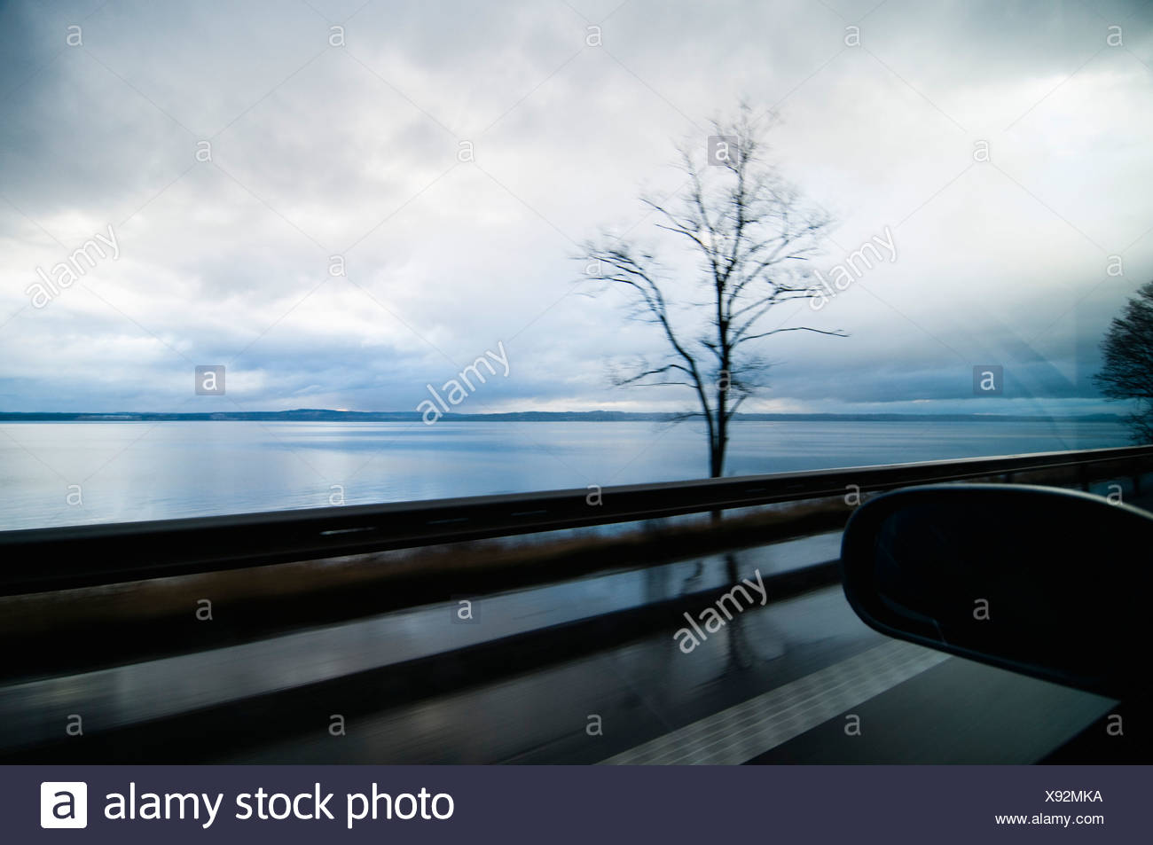 View over lake from car window Stock Photo