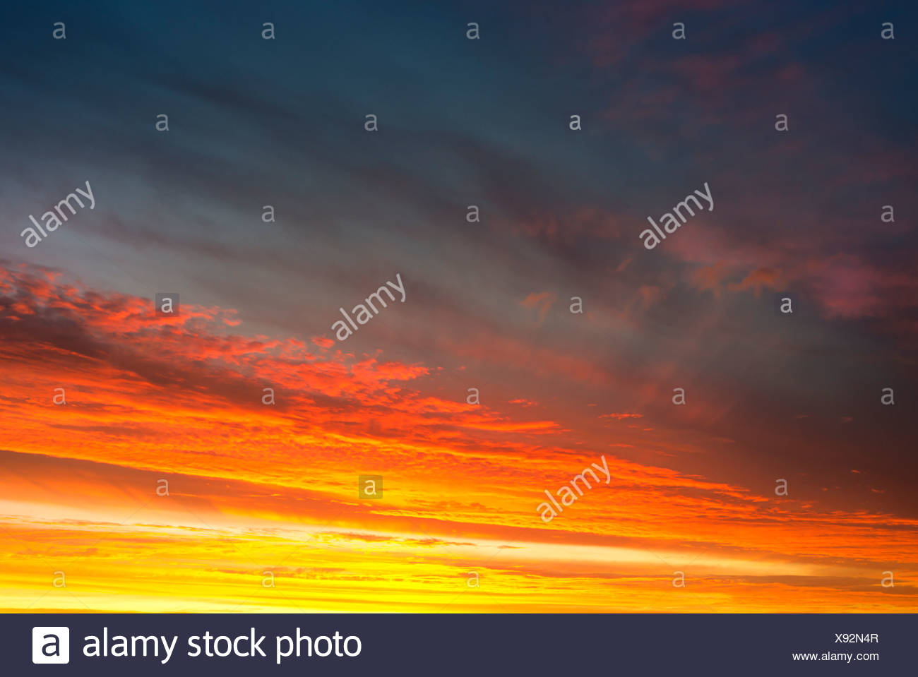 Clouds at dusk above the Atlantic Ocean beach, Finistère, Brittany, France, Europe - Stock Image
