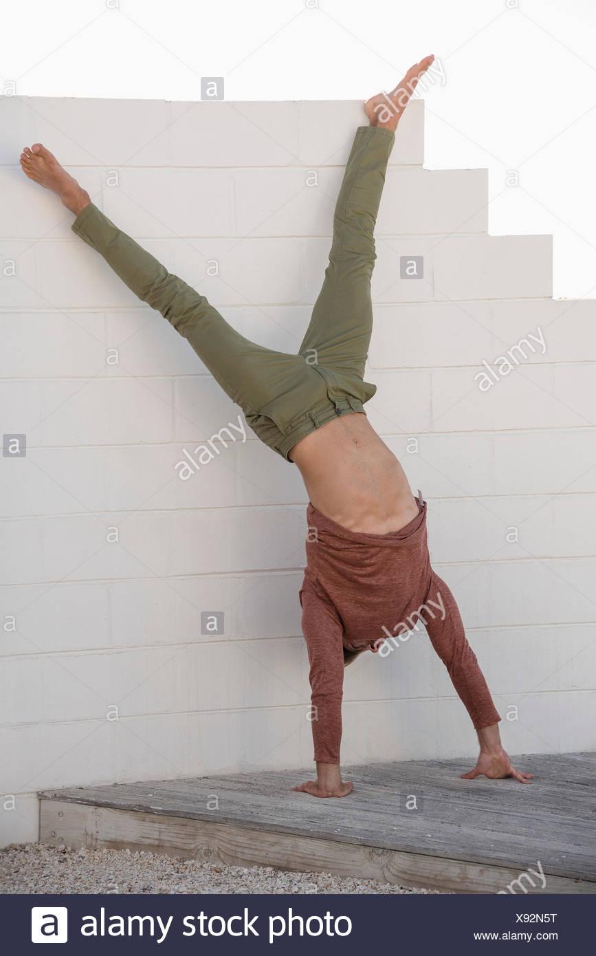 Man doing cartwheel - Stock Image