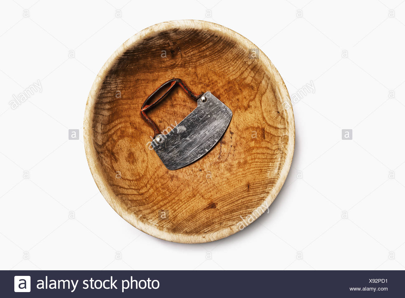 A well worn wooden chopping bowl, with a steel blade and handle. - Stock Image