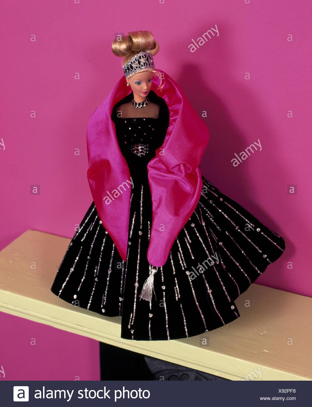 Close-up of a Barbie style doll dressed in hand made evening gown ...