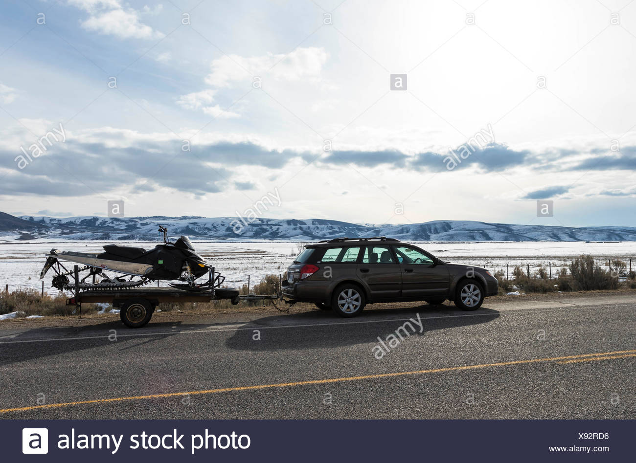 Station Wagon with Snowmobile - Stock Image