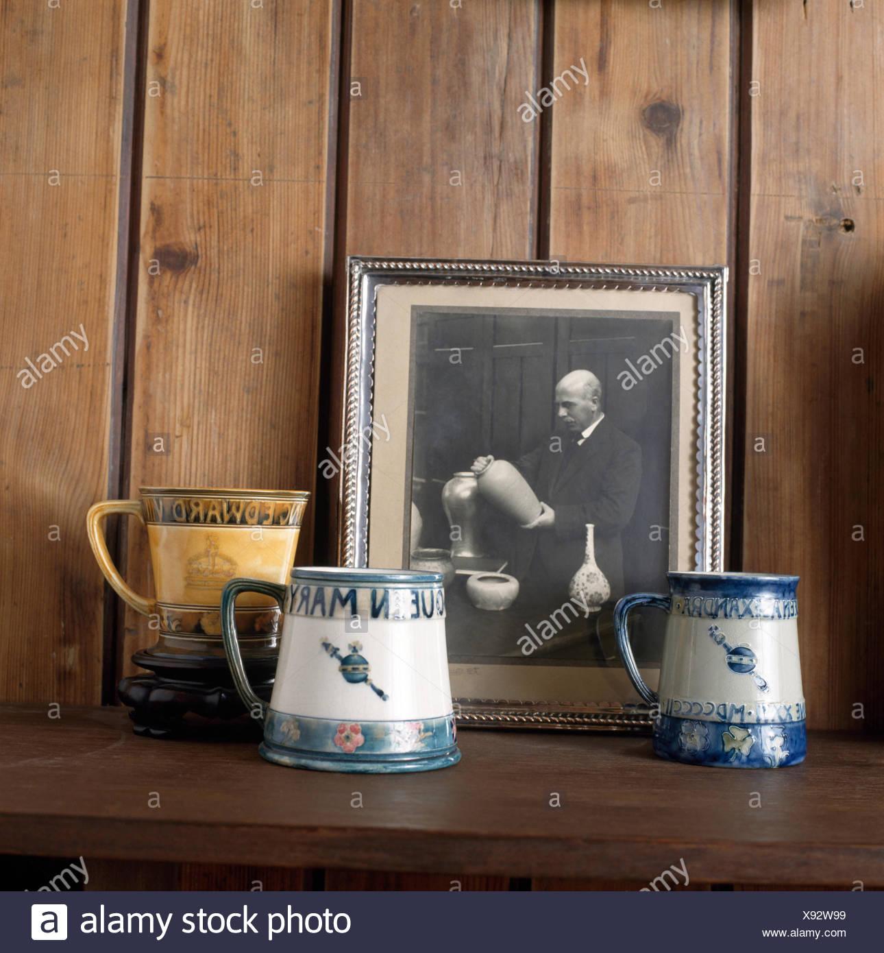 Close-up of Moorcroft mugs with a black+white  photograph of William Moorcraft - Stock Image
