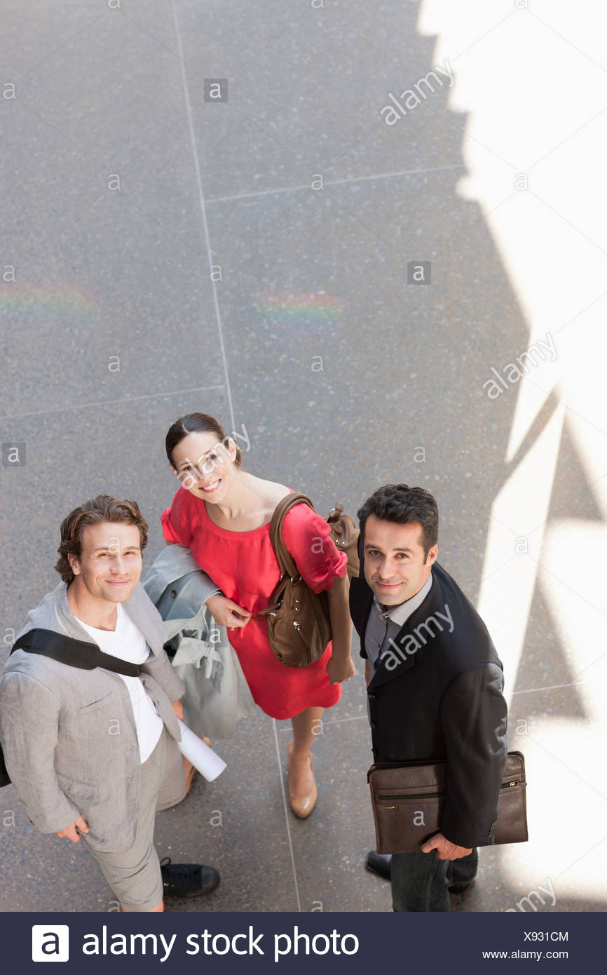 Business people talking on sidewalk - Stock Image