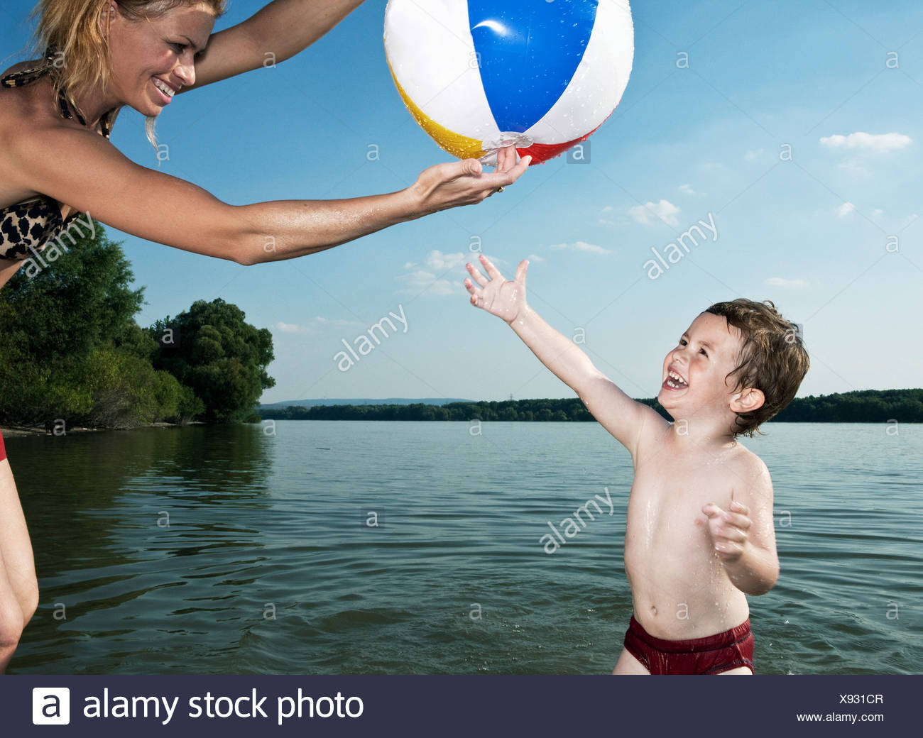 child trying to get ball - Stock Image