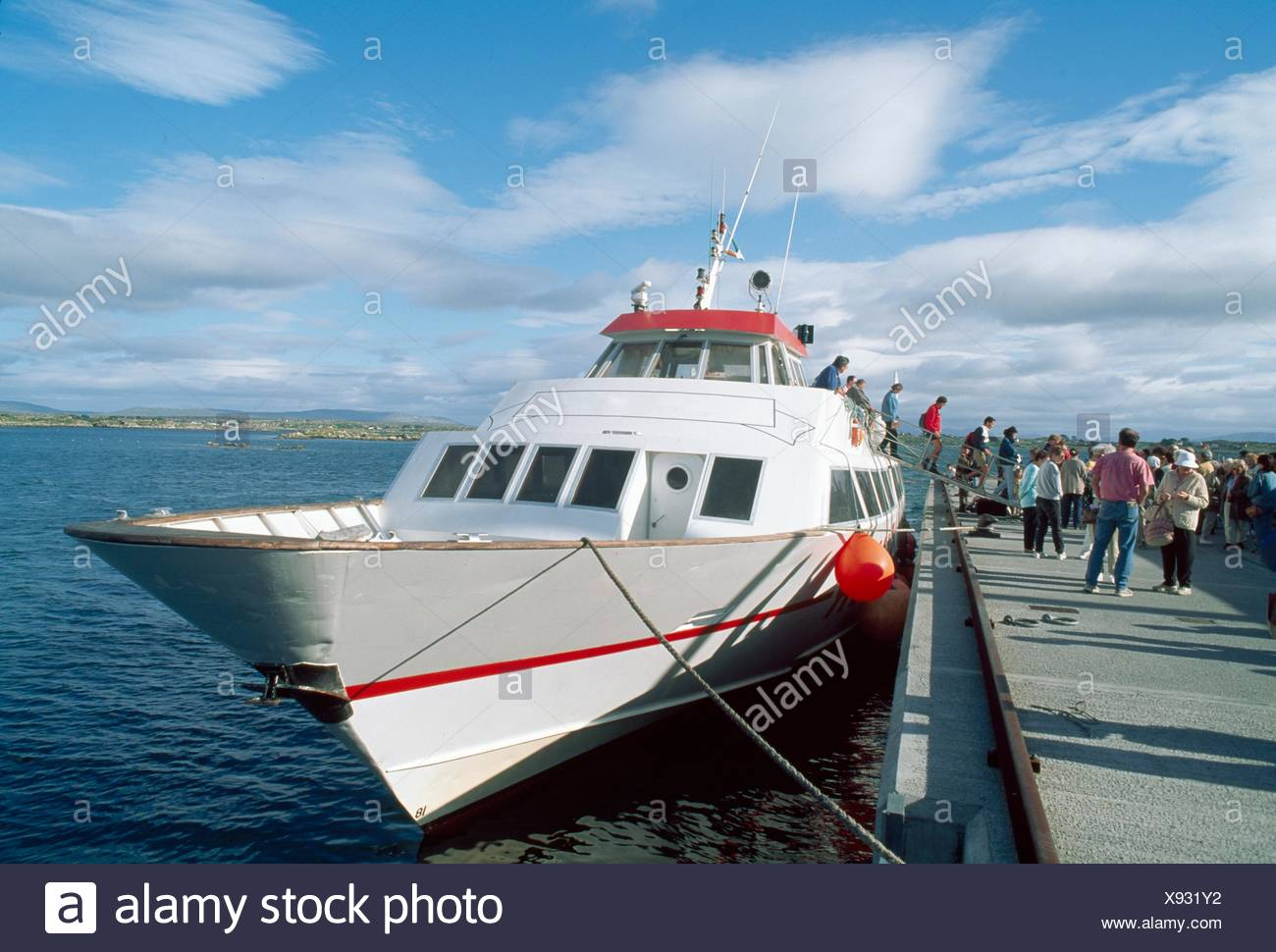 Aran Flyer Ferry, Aran Islands, Co Galway, Ireland; People Next To A Ferry - Stock Image