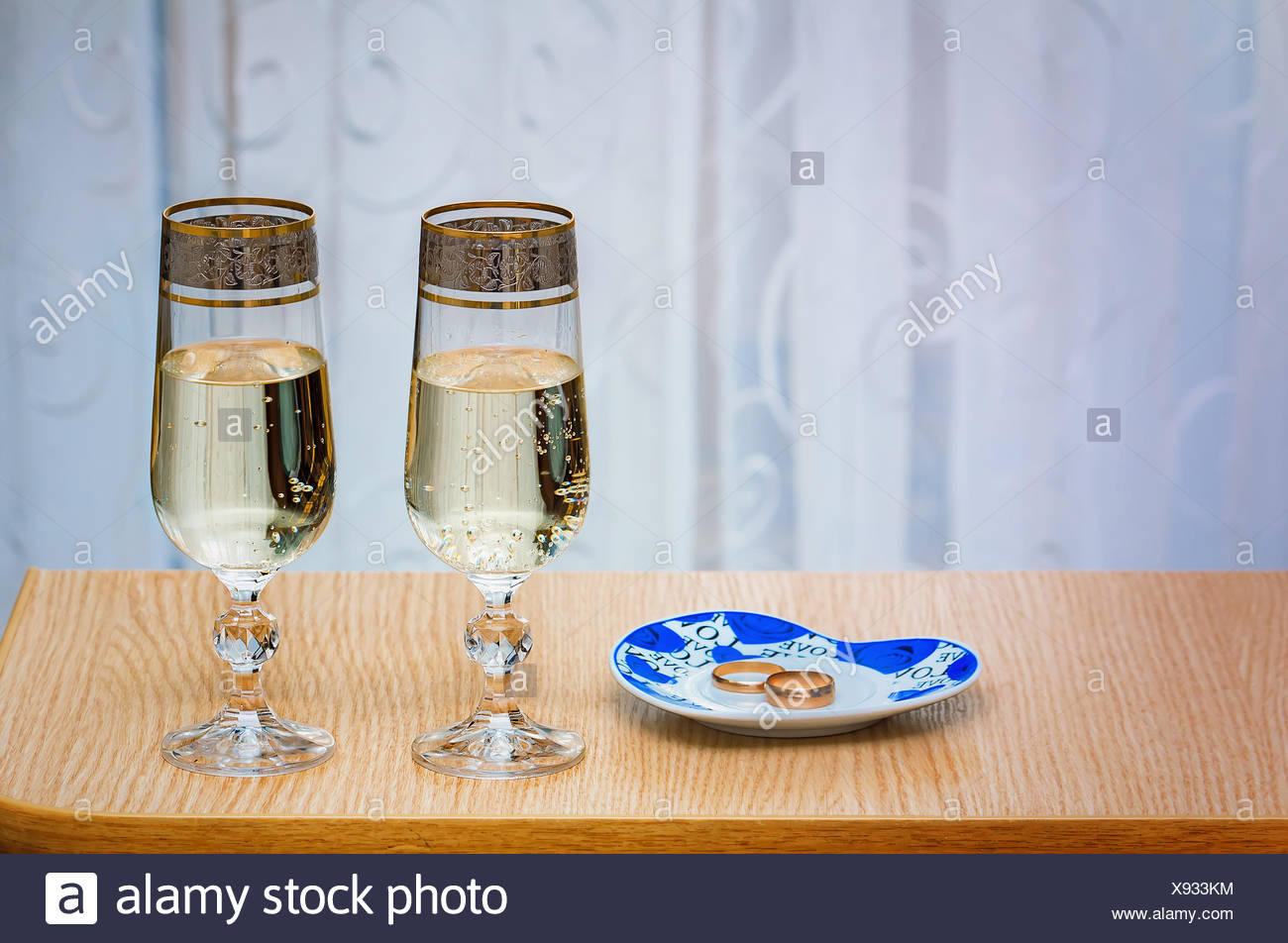 Two champagne flute filled with champagne. - Stock Image
