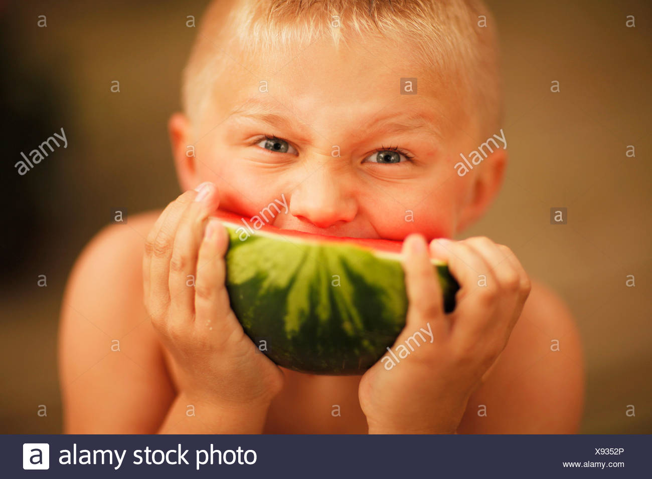 Boy Eating A Slice Of Watermelon Stock Photo