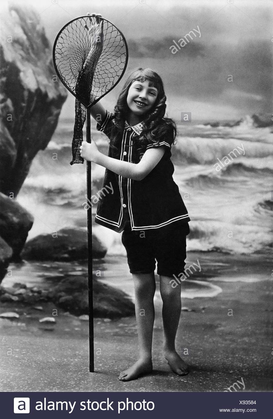 bathing, beach fashion, girl in cossie with hand net, 1920s, Additional-Rights-Clearences-NA - Stock Image
