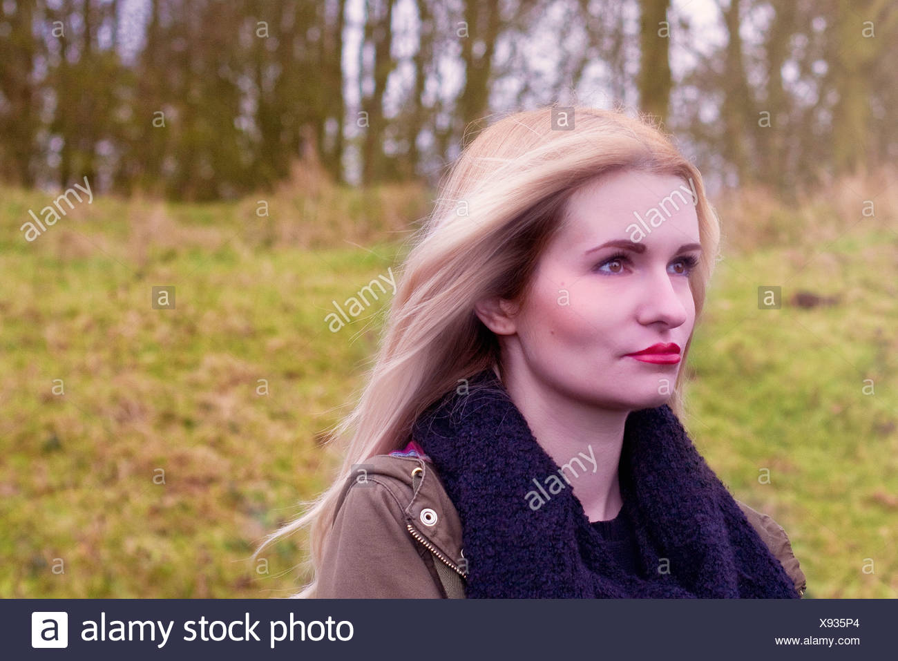 Portrait of sad young woman outdoors - Stock Image