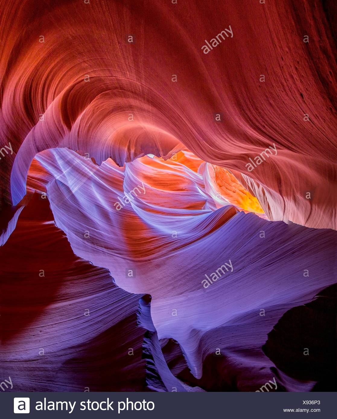 Bright hues of orange,magenta , yellow and blue come alive at Antelope Canyon, Arizona. - Stock Image