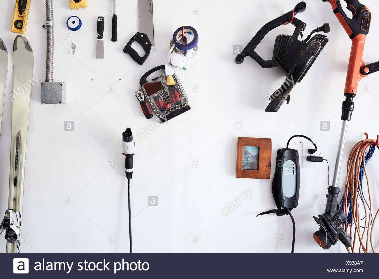 Assortment of gadgets and tools on wall - Stock Image