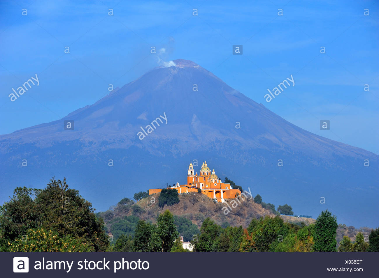 Church of Iglesia Nuestra Senora de los Remedios on the ruins of the pre-Hispanic Pyramid of Cholula in front of the active - Stock Image