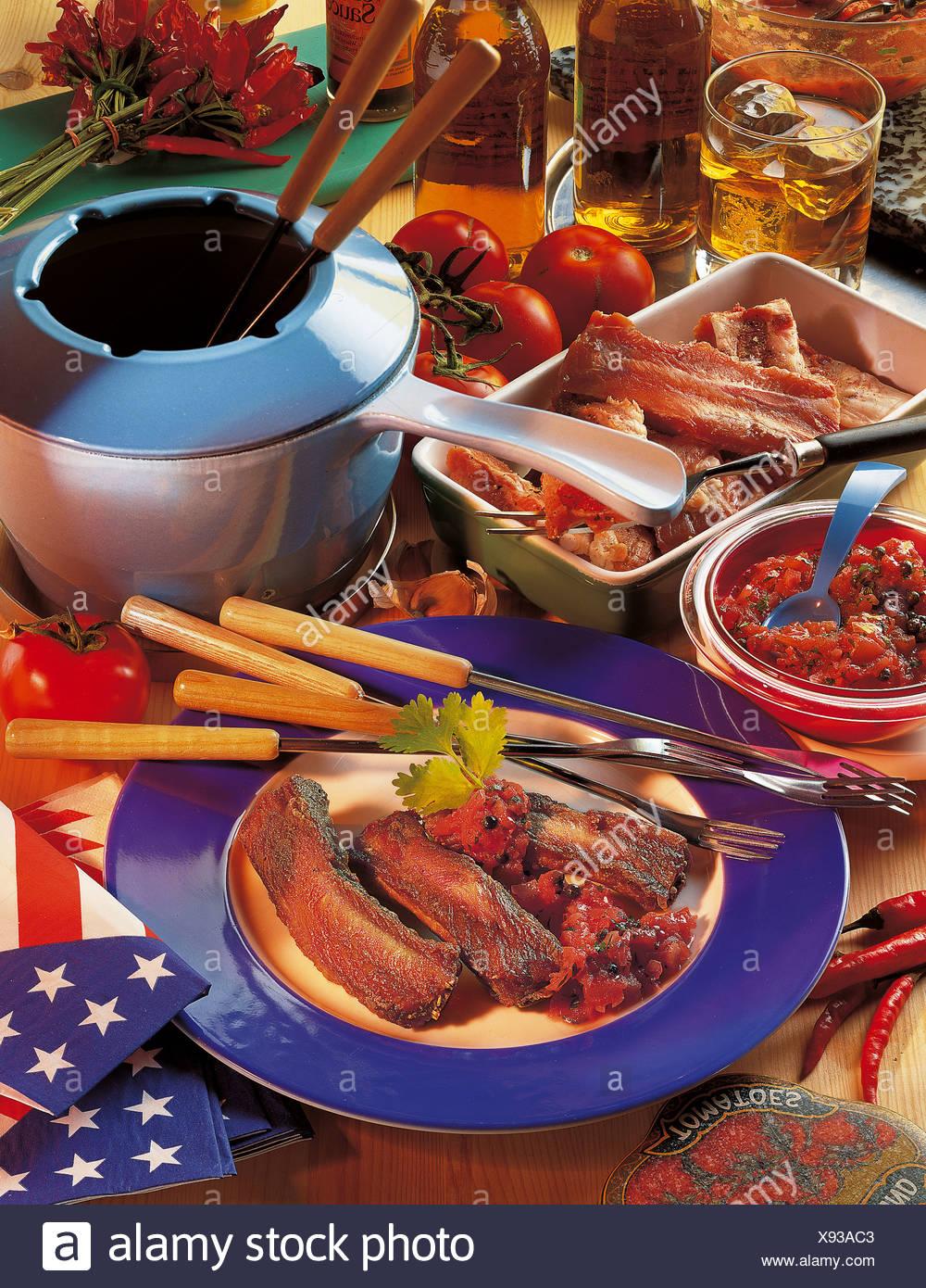 Texan spare ribs fondue, USA, recipe available for a fee - Stock Image