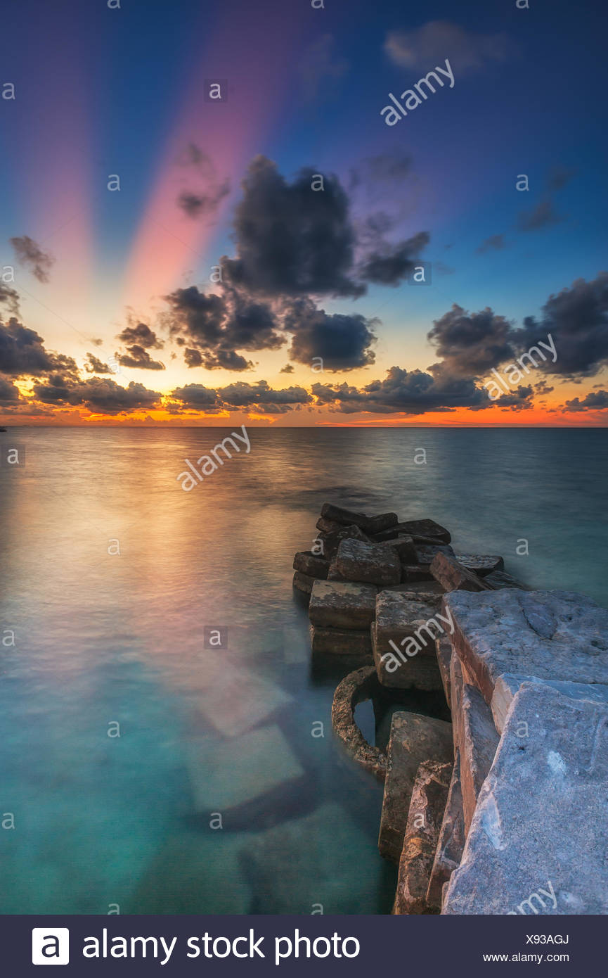 Malaysia, Sabah, Ray of Light sunset at Mabul Island - Stock Image