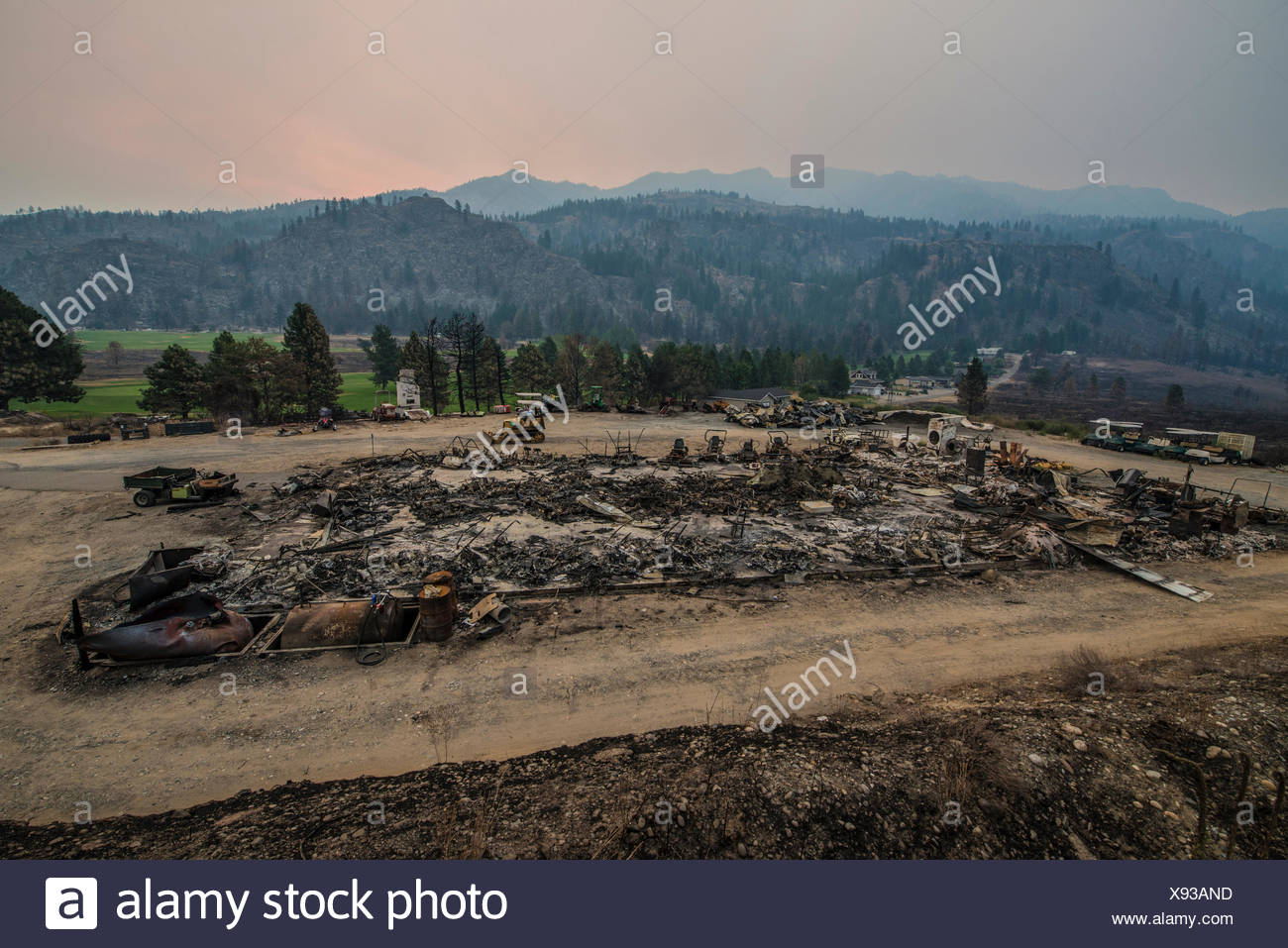 The remains of the Alta Lake golf course grounds keeping hut after a wildfire moved through the area. - Stock Image